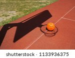 basketball on a court placed... | Shutterstock . vector #1133936375