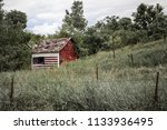 a small  neglected cabin with... | Shutterstock . vector #1133936495
