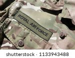 Close up of the Royal Air Force badge on a UK military camouflage uniform symbolising the UK military, RAF and the centenary of the First World War