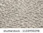 Small photo of Beach sand with pattern of ridges, like a washboard, along intertidal zone on barrier island, for background or element with themes of cause and effect
