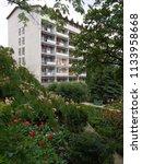 spacious balconies of a... | Shutterstock . vector #1133958668