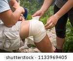 hiking first aid  girl helps an ... | Shutterstock . vector #1133969405