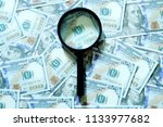financial concept. magnifying... | Shutterstock . vector #1133977682