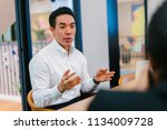a chinese asian business man in ... | Shutterstock . vector #1134009728