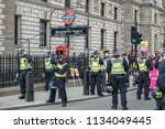 Small photo of London,UK - July 14 2018: Anti-fascists protest with counter rally against Tommy Robinson supporters in London.