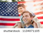 father with son piggy back... | Shutterstock . vector #1134071105