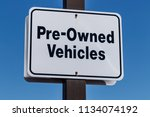 pre owned vehicles sign at a... | Shutterstock . vector #1134074192