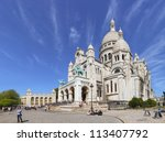 PARIS - MAY 19: The Basilica of Sacre Coeur on May 19, 2010, Paris, France. Basilica is a famous catholic church in Paris. It is located at the highest point in the city. - stock photo