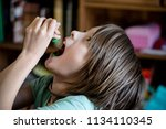 a child is eating icing... | Shutterstock . vector #1134110345
