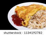 omelet on rice with ketchup... | Shutterstock . vector #1134192782