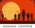 Silhouette Of Five Cowboys...