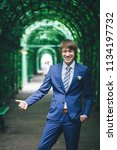 bridegroom during a wedding walk | Shutterstock . vector #1134197732