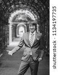bridegroom during a wedding walk | Shutterstock . vector #1134197735