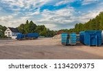 recycling yard with trucks and... | Shutterstock . vector #1134209375