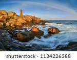 lighthouse among the red rocks... | Shutterstock . vector #1134226388