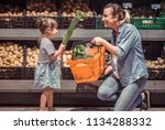 mom and daughter are shopping... | Shutterstock . vector #1134288332