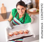 woman is making cakes in the... | Shutterstock . vector #1134299192