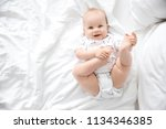 cute little baby lying on bed ... | Shutterstock . vector #1134346385