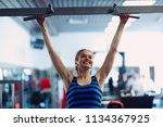 young woman exercising. fitness ... | Shutterstock . vector #1134367925