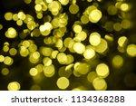 a generic warm golden bokeh... | Shutterstock . vector #1134368288