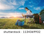 asian woman camping and... | Shutterstock . vector #1134369932