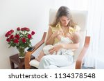 young mother holding her baby... | Shutterstock . vector #1134378548