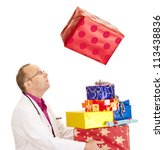 A doctor catching a very big gift - stock photo