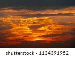 beautiful sunset  yellow clouds | Shutterstock . vector #1134391952