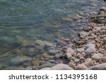 the stone edge of the river | Shutterstock . vector #1134395168