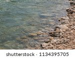 the stone edge of the river | Shutterstock . vector #1134395705