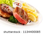 grilled steaks and vegetables | Shutterstock . vector #1134400085