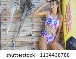 amazing surfer girl | Shutterstock . vector #1134438788