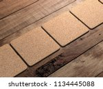 cork pads mockup on the wooden... | Shutterstock . vector #1134445088