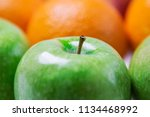 green apples  oranges and red... | Shutterstock . vector #1134468992