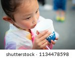 girl to enjoy the summer... | Shutterstock . vector #1134478598