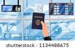 hand with passport and airline... | Shutterstock . vector #1134488675