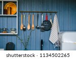 cooking utensils hanging on... | Shutterstock . vector #1134502265