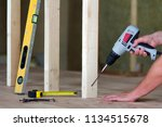 close up of worker's hands with ... | Shutterstock . vector #1134515678
