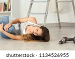 domestic accident of a woman... | Shutterstock . vector #1134526955