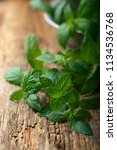 fresh mint in a rustic metal... | Shutterstock . vector #1134536768