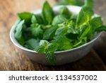 fresh mint in a rustic metal... | Shutterstock . vector #1134537002
