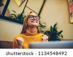 happy female freelancer feeling ... | Shutterstock . vector #1134548492