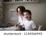 happy mother is engaged in a... | Shutterstock . vector #1134566945