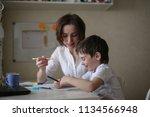 beautiful woman tutor is... | Shutterstock . vector #1134566948