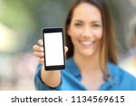 girl hand showing a phone... | Shutterstock . vector #1134569615