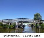 wooden bridge over dutch... | Shutterstock . vector #1134574355
