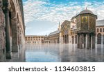 day panoramic view of the umayyad mosque under the blue sky and white clouds. showing the islamic architecture and islamic art in this holy place in damascus syria.