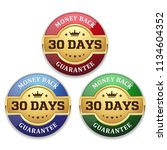 three golden money back badges... | Shutterstock .eps vector #1134604352