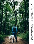 man with a dog in the forest | Shutterstock . vector #1134637175