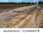 damaged road  cracked asphalt... | Shutterstock . vector #1134666278